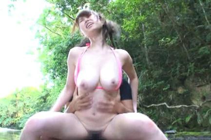 Nanako Mizukawa is doggy nailed on rocks surrounded by water