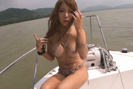 Asuka hoshino. Asuka Hoshino Asian rubs penis of her round cans on the yacht
