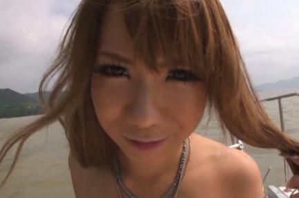 Asuka hoshino. Asuka Hoshino Asian rubs penis of her round cans