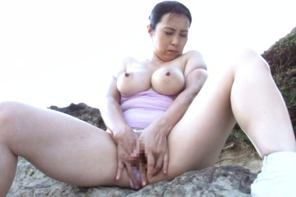 Yuuko kuremachi. Yuuko Kuremachi with huge nude tits rubs her clitoris on rocks